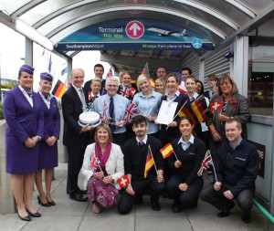 Photo includes Dave Lees and airport staff celebrating the Outstanding Contribution to Hampshire Award with a chocolate cake.